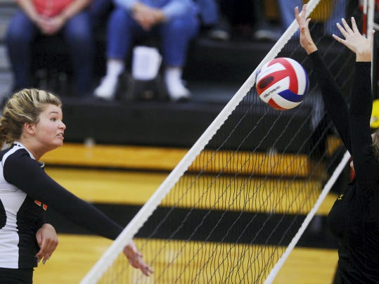 Central York's Natalie Hawksworth, left, scores against Red Lion during Tuesday's match at Red Lion. Hawskworth had four kills in the Panthers' 25-15, 25-22, 25-22 victory that secured the YAIAA Division I title.