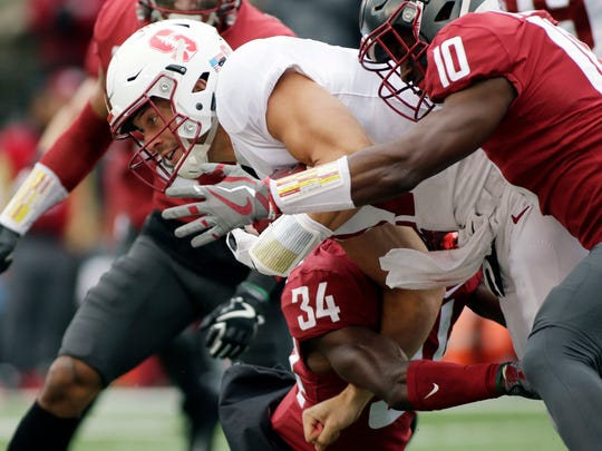 Washington State defensive back Kirkland Parker (10) and safety Jalen Thompson (34) tackle Stanford quarterback Ryan Burns during the first half of an NCAA college football game in Pullman, Wash., Saturday, Nov. 4, 2017. (AP Photo/Young Kwak)