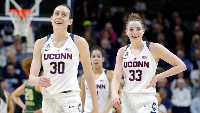 Connecticut Huskies forward Breanna Stewart (30) and guard/forward Katie Lou Samuelson (33) on the court against the South Florida Bulls in the second half at Gampel Pavilion. UConn defeated South Florida 79-59.