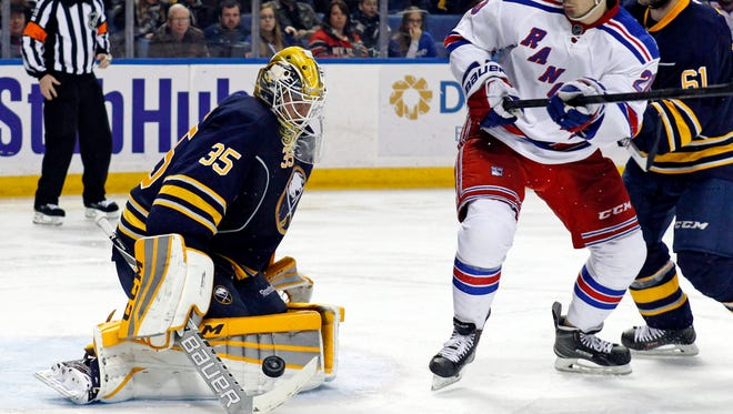 Buffalo Sabres goalie Anders Lindback (35) makes a save on a shot by New York Rangers left wing Chris Kreider (20) during the third period at First Niagara Center. Rangers beat the Sabres 2-0. Mandatory Credit: Kevin Hoffman-USA TODAY Sports
