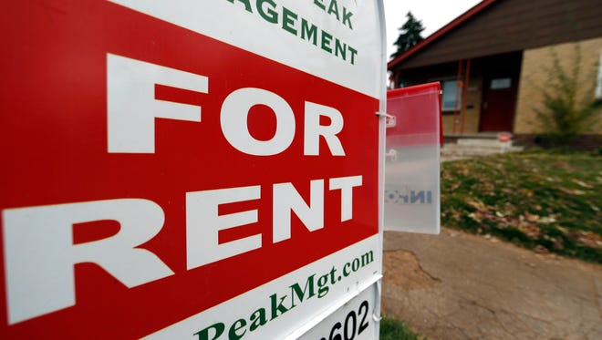 A rental sign is seen outside a property.
