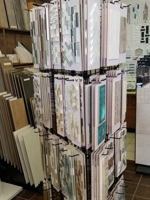 While it takes a Masters' touch to perfectly set a new tile floor, one must be a careful designer to select the proper supplies from the myriad of flooring showrooms.