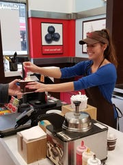 Lindsey Kolanowski serves a customer at Red Mango.