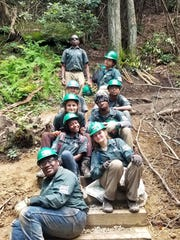 The North Carolina Youth Conservation Corps worked on more than 10 miles of trails in the Pisgah National Forest this summer. In front is Sinclair Biles. Comfort Johnson and Kate Kulinski, second row. Lyra Aquino and Brian Allison are in third row. Noelle Rizzardi and Roman Watson are in the fourth row. Branson Williams is on the right in the back.