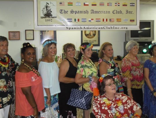 Door prize winners were Al Manzanares, from left, Maritza Rivera, Aida Veléz, Carly Werhly, María Allean, Yvonne Bonet, Ligia Bernas, Isa Bryson and Xiomara Guanill, seated.