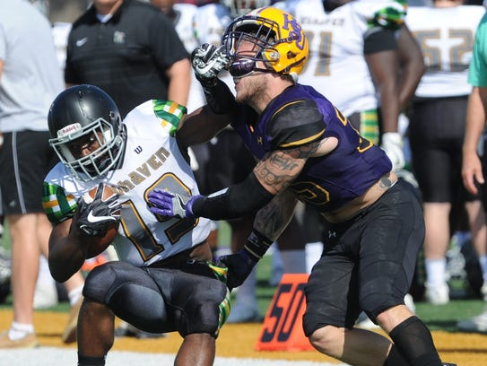 Belhaven's Marquis Hodge, left, tries to push away
