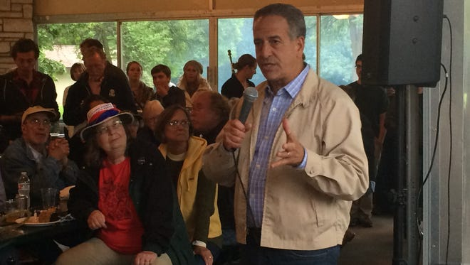 Former Sen. Russ Feingold talks to local Democrats at a corn roast in Kimberly Monday, Aug. 24, 2015.