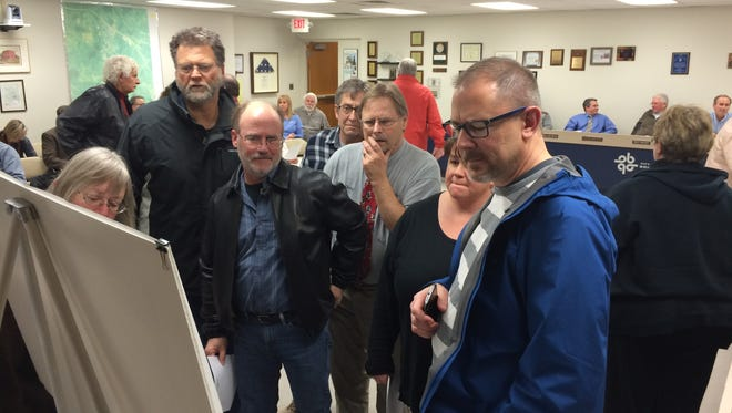 Brighton residents review the site plan for the senior housing complex on Monday.