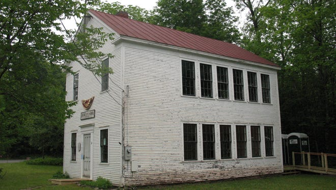 Old Schoolhouse, Underhill Center,  showing north and west sides with deteriorated clapboards.