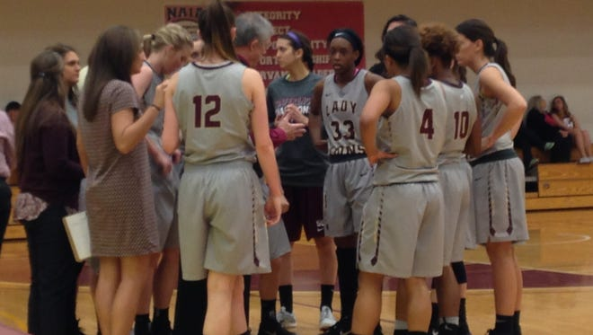 Freed-Hardeman coach Dale Neal talks to his players Thursday in the AMC quarterfinals. FHU won 63-58.