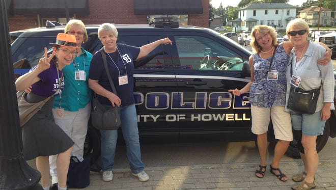 This parked police patrol vehicle was fair game during Wednesday's pub crawl.