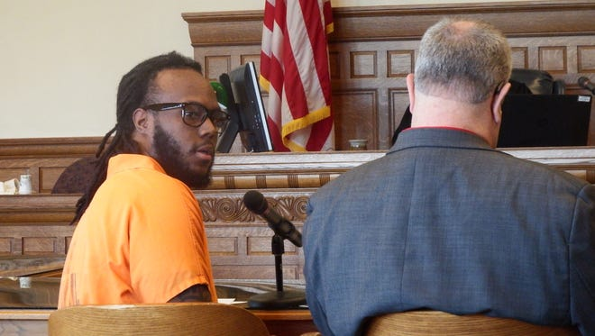 Justin Marshall apologizes to the family of John Versypt at his sentencing Friday at the Johnson County Courthouse on charges of voluntary manslaughter, second-degree robbery and intimidation with a dangerous weapon in Versypt's death in 2009.