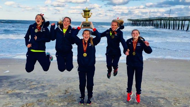 Cleary University runners (left to right) Madison Paquette, Aleighsha Engisch, Breunisje Kass-McGrady, Natasha Stevenson and Alyssa Lane celebrate a USCAA national championship in Virginia Beach, Va.
