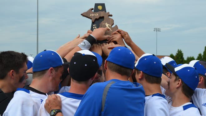 Harper Creek celebrates winning a district title in baseball at Coldwater.