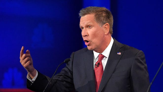 Gov. John Kasich makes a point during the CNBC Republican presidential debate at the University of Colorado on Wednesday.