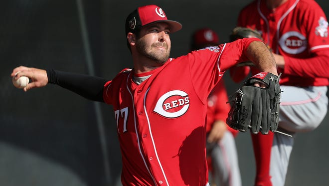 Cincinnati Reds relief pitcher Dylan Floro (77) delivers in the bullpen, Saturday, Feb. 17, 2018, at the Cincinnati Reds Spring Training facility in Goodyear, Arizona.
