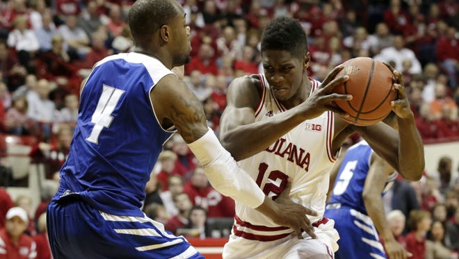 Indiana forward Hanner Mosquera-Perea (12) works against New Orleans forward Kevin Hill (4) during a NCAA men's basketball game on Monday, Dec. 22, 2014, at Assembly Hall in Bloomington.