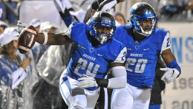 Blue Raiders linebacker Cavellis Luckett (24) and safety Kevin Byard (20) will both showcase their skills in front of NFL scouts on Thursday.