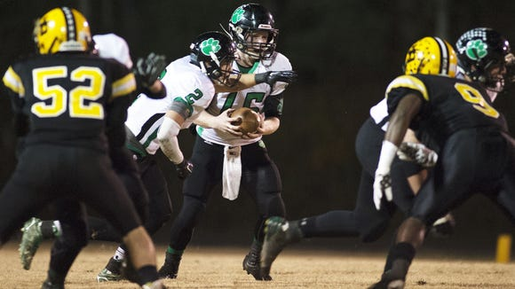 Britt Burleson (2) prepares to take a handoff during a NCHSAA playoff game at Lincolnton in November.