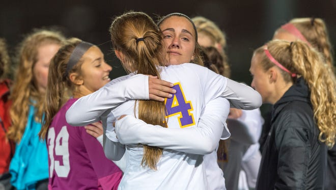 Guerin Catholic High School seniors Adele Stradling (21), right, and Elle Vuotto (14) react after the team's loss of the IHSAA Girls' Soccer Class 3A state final game, Friday, October 27, 2017, at the Bud and Jackie Sellick Bowl on the campus of Butler University in Indianapolis. Penn High School won 2-0.
