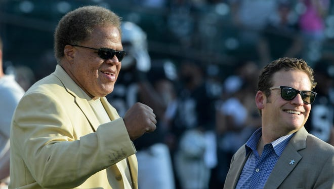 Oakland Raiders general manager Reggie McKenzie (left) and Seattle Seahawks general manager John Schneider (right) talk prior to a preseason game in Oakland.