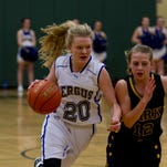 Fergus High's Carley Carpenter (20) drives past Park's Meghan Gibson (12) on her way to the basket Monday.