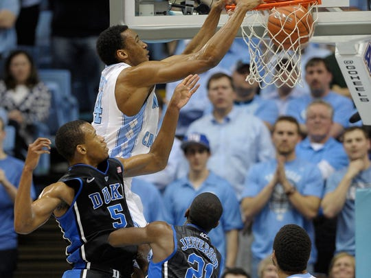 North Carolina's Desmond Hubert dunks during a game