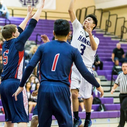 Mission Oak's Josh Garcia (3) rises for a shot against Tulare Western on Tuesday in an East Yosemite League showdown.