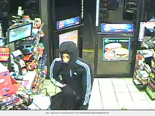 636368618134712895-Suspect-inside-store-by-counter-face-.JPG