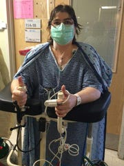 Tammy Shackett gives a thumbs up after undergoing a double-lung transplant surgery in Boston.