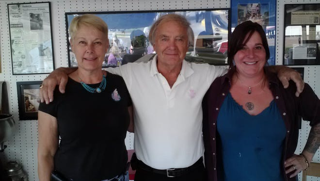 A 2012 photo of Marilyn Caves and Jim Graves before they passed ownership of Snookies Malt Shop to their daughter, Brandi Proulx (right.)