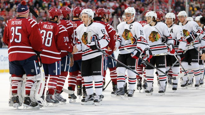The victorious Washington Capitals shake hand with Chicago's Patrick Kane and Jonathan Toews on Thursday.