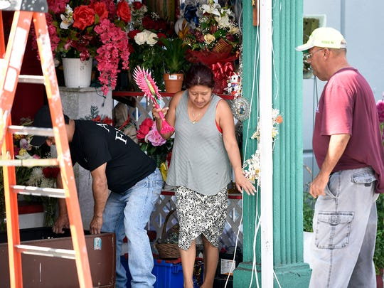 The shrine to Our Lady of Guadalupe is dismantled on Aug. 16 in Passaic.