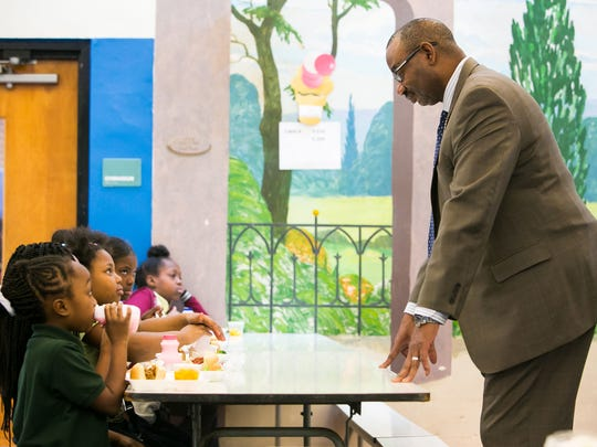 Principal Jeffers Brown chats with third graders during lunch time at Stubbs Elementary School in Wilmington. A mystery donor paid $1,200 to cover the lunch bills for all students.