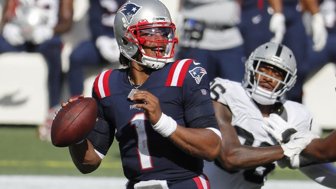 New England Patriots quarterback Cam Newton looks to pass against the Las Vegas Raiders during an NFL football game at Gillette Stadium, Sunday, Sept. 27, 2020 in Foxborough, Mass.