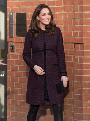 Duchess Kate parties in plum at the Rugby Portobello Trust on Tuesday.