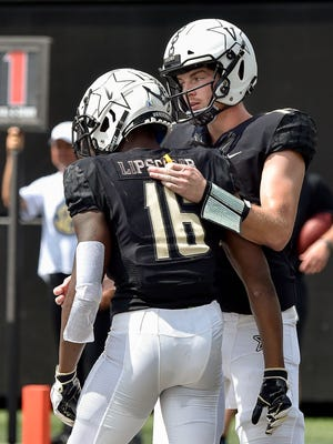 Vanderbilt quarterback Kyle Shurmur (14) congratulates wide receiver Kalija Lipscomb (16) on his touchdown against Nevada during the first half at Vanderbilt University in Nashville, Tenn., Saturday, Sept. 8, 2018.