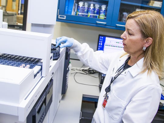 Forensic scientist Erika Canonico uses the separation and identification instrument at the Arizona Department of Public Safety Crime Lab in Phoenix, Tuesday, September 12, 2017.