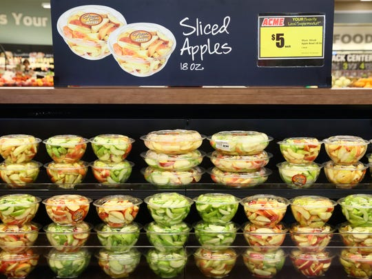 There's a variety of fresh sliced apples at Acme Markets.