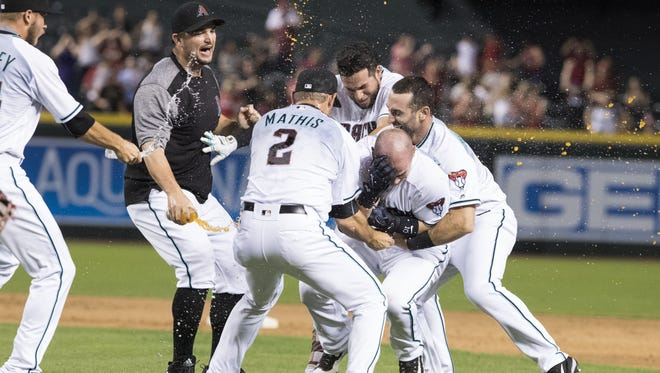 The Arizona Diamondbacks react after they beat the St. Louis Cardinals in the 10th inning on Tuesday, June 27, 2017 at Chase Field in Phoenix, Ariz.