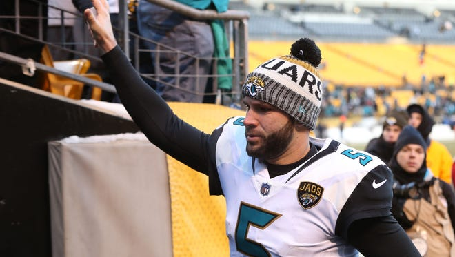 Jacksonville Jaguars quarterback Blake Bortles (5) celebrates with fans in the stands after defeating the Pittsburgh Steelers in the AFC Divisional Playoff game 45-42 at Heinz Field.