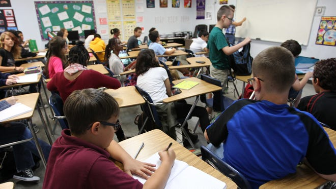 A science class at Sonoran Science Academy in Peoria. The charter school has come under fire for a line printed next to a student's yearbook picture.