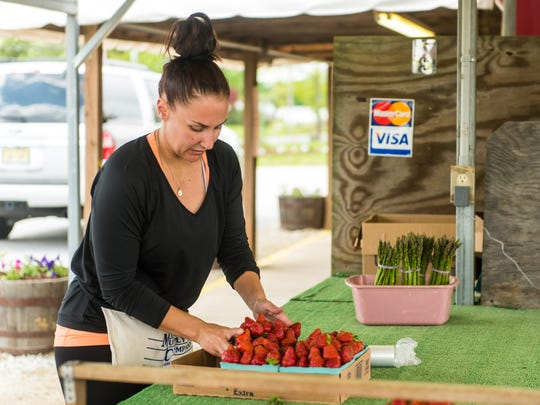 Kristie Mosley packages strawberries to be sold at Sparacio Farms in Rosenhayn on Tuesday, May 2.