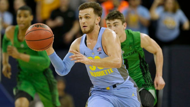 Marquette guard Andrew Rowsey moves the ball against Oregon during a second round NIT game Sunday at the Al McGuire Center.