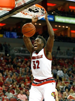 Louisville's Chinanu Onuaku slams one home to get the crowd into the game against Samford. Nov. 13, 2015