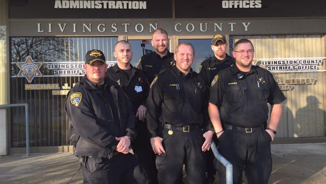 Livingston County Sheriff's officers refrained from shaving off their beards throughout the entire month of November to raise money and awareness for cancer. Pictured participants include, from left, Corrections Deputy Kasey Howe, Sgt. Dan Knapp, Sgt. Roy Asquith, Deputy Kurt Heiob, Corrections Deputy Scott Stone and Deputy Mike Hatfield.