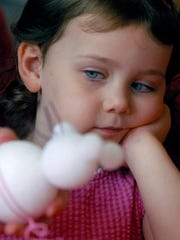 Gillian Cabrera, 4, contemplates the mouse her mother