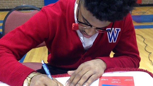 Woodlawn's Matthew Williams signs with Fort Scott Community College on Wednesday.