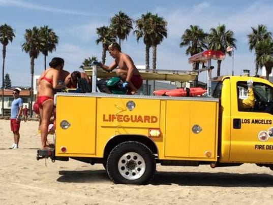Lifeguards work to revive a person believed injured by a lightning strike  at Venice beach in Los Angeles Sunday afternoon in this photo from Twitter   Photo   Lightning kills man at Los Angeles beach. Old Lightning Venice Ca. Home Design Ideas