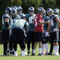 Philadelphia Eagles quarterback Sam Bradford (7) huddles with his teammates at the team's practice facility Thursday in Philadelphia.